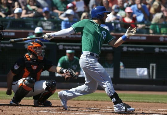 Mar 17, 2019; Scottsdale, AZ, USA; Kansas City Royals left fielder Alex Gordon (4) hits a single against the San Francisco Giants in the second inning during a spring training game at Scottsdale Stadium. Mandatory Credit: Rick Scuteri-USA TODAY Sports