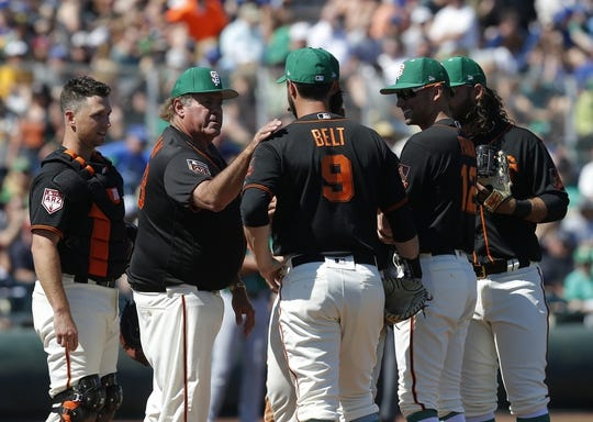 Mar 17, 2019; Scottsdale, AZ, USA; TV analyst Chris Berman holds a meeting on the mound with the San Francisco Giants in the third inning during a spring training game against the Kansas City Royals at Scottsdale Stadium. Mandatory Credit: Rick Scuteri-USA TODAY Sports