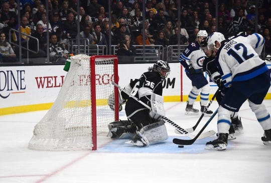 Mar 18, 2019; Los Angeles, CA, USA; Winnipeg Jets right wing Kevin Hayes (12) shoots the puck past Los Angeles Kings goaltender Jack Campbell (36) for a goal in the first period at Staples Center. Mandatory Credit: Kirby Lee-USA TODAY Sports