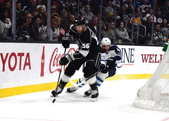 Mar 18, 2019; Los Angeles, CA, USA; Los Angeles Kings defenseman Kurtis MacDermid (56) and Winnipeg Jets center Bryan Little (18) battle for the puck in the first period at Staples Center. Mandatory Credit: Kirby Lee-USA TODAY Sports