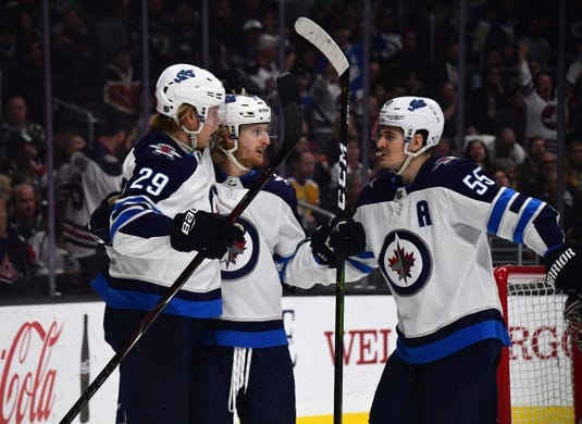 Mar 18, 2019; Los Angeles, CA, USA; Winnipeg Jets left wing Kyle Connor (81) celebrates with right wing Patrik Laine (29) and center Mark Scheifele (55) after scoring a goal against the Los Angeles Kings in the first period at Staples Center. Mandatory Credit: Kirby Lee-USA TODAY Sports