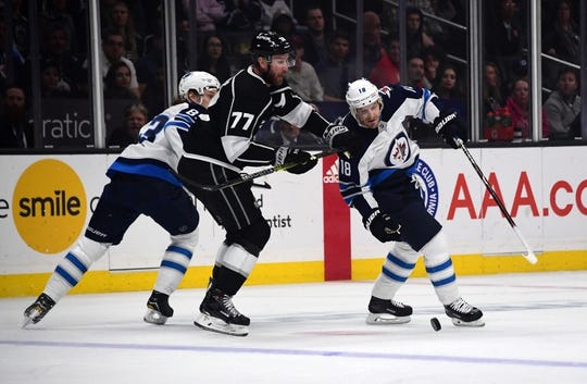 Mar 18, 2019; Los Angeles, CA, USA; Los Angeles Kings center Jeff Carter (77) and Winnipeg Jets center Bryan Little (18) battle for the puck  in the first period at Staples Center. Mandatory Credit: Kirby Lee-USA TODAY Sports