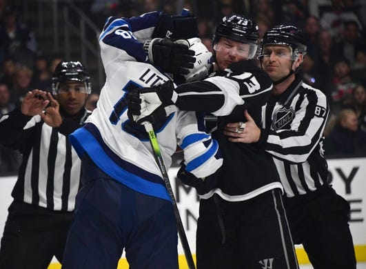 Mar 18, 2019; Los Angeles, CA, USA; Los Angeles Kings left wing Kyle Clifford (13) and Winnipeg Jets center Bryan Little (18) fight in the second period at Staples Center. Mandatory Credit: Kirby Lee-USA TODAY Sports