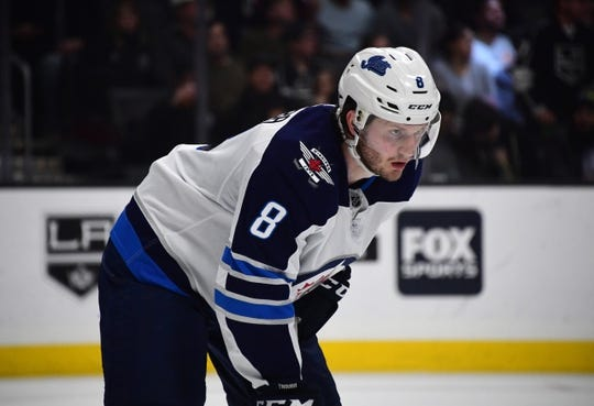 Mar 18, 2019; Los Angeles, CA, USA; Winnipeg Jets defenseman Jacob Trouba (8) reacts against the Los Angeles Kings in the second period at Staples Center. The Jets defeated the Kings 3-2. Mandatory Credit: Kirby Lee-USA TODAY Sports