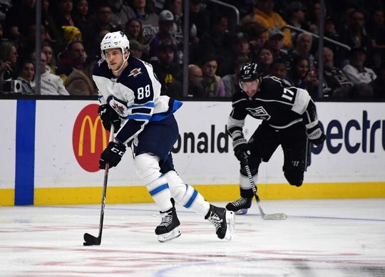 Mar 18, 2019; Los Angeles, CA, USA; Winnipeg Jets defenseman Nathan Beaulieu (88) is pursued by Los Angeles Kings left wing Ilya Kovalchuk (17) in the third period at Staples Center. The Jets defeated the Kings 3-2. Mandatory Credit: Kirby Lee-USA TODAY Sports
