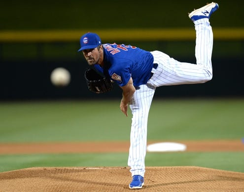 Mar 20, 2019; Mesa, AZ, USA; Chicago Cubs starting pitcher Cole Hamels (35) pitches against the Los Angeles Dodgers during the first inning at Sloan Park. Mandatory Credit: Joe Camporeale-USA TODAY Sports