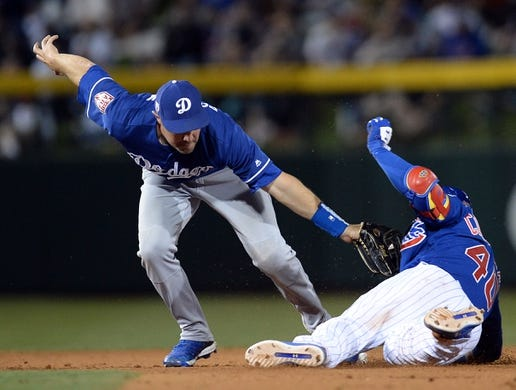 Mar 20, 2019; Mesa, AZ, USA; Los Angeles Dodgers center fielder A.J. Pollock (11) tags out Chicago Cubs catcher Willson Contreras (40) at second base during the fourth inning at Sloan Park. Mandatory Credit: Joe Camporeale-USA TODAY Sports