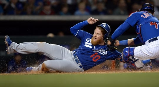Mar 20, 2019; Mesa, AZ, USA; Los Angeles Dodgers third baseman Justin Turner (10) slides safely at home plate ahead of a throw to Chicago Cubs catcher Willson Contreras (40) during the fifth inning at Sloan Park. Mandatory Credit: Joe Camporeale-USA TODAY Sports
