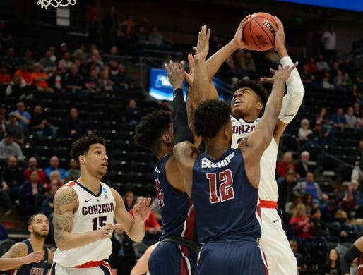 Mar 21, 2019; Salt Lake City, UT, USA; Gonzaga Bulldogs forward Rui Hachimura (21) shoots against Fairleigh Dickinson Knights forward Kaleb Bishop (12)  in the first round of the 2019 NCAA Tournament at Vivint Smart Home Arena. Mandatory Credit: Gary A. Vasquez-USA TODAY Sports