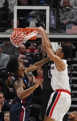 Mar 21, 2019; Salt Lake City, UT, USA; Gonzaga Bulldogs forward Brandon Clarke (15) dunks over Fairleigh Dickinson Knights forward Mike Holloway Jr. (34) in the first half in the first round of the 2019 NCAA Tournament at Vivint Smart Home Arena. Mandatory Credit: Kirby Lee-USA TODAY Sports