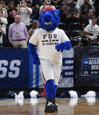 Mar 21, 2019; Salt Lake City, UT, USA; Fairleigh Dickinson Knights mascot performs against the Gonzaga Bulldogs in the first round of the 2019 NCAA Tournament at Vivint Smart Home Arena. Mandatory Credit: Kirby Lee-USA TODAY Sports