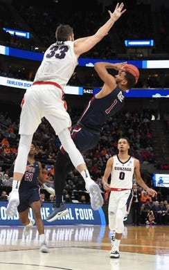 Mar 21, 2019; Salt Lake City, UT, USA; Fairleigh Dickinson Knights guard Darnell Edge (1) shoots against Gonzaga Bulldogs forward Killian Tillie (33) in the first half in the first round of the 2019 NCAA Tournament at Vivint Smart Home Arena. Mandatory Credit: Kirby Lee-USA TODAY Sports