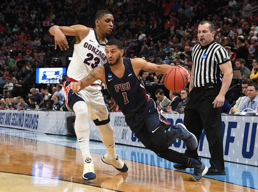 Mar 21, 2019; Salt Lake City, UT, USA; Fairleigh Dickinson Knights guard Darnell Edge (1) drives around Gonzaga Bulldogs guard Zach Norvell Jr. (23) in the first half in the first round of the 2019 NCAA Tournament at Vivint Smart Home Arena. Mandatory Credit: Kirby Lee-USA TODAY Sports