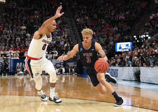 Mar 21, 2019; Salt Lake City, UT, USA; Fairleigh Dickinson Knights guard Jahlil Jenkins (3) dribbles the ball against Gonzaga Bulldogs guard Geno Crandall (0) in the first half in the first round of the 2019 NCAA Tournament at Vivint Smart Home Arena. Mandatory Credit: Kirby Lee-USA TODAY Sports