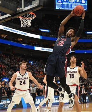 Mar 21, 2019; Salt Lake City, UT, USA; Fairleigh Dickinson Knights forward Kaleb Bishop (12) gets a rebound in front of Gonzaga Bulldogs forward Corey Kispert (24) and forward Brandon Clarke (15) in the first half in the first round of the 2019 NCAA Tournament at Vivint Smart Home Arena. Mandatory Credit: Kirby Lee-USA TODAY Sports