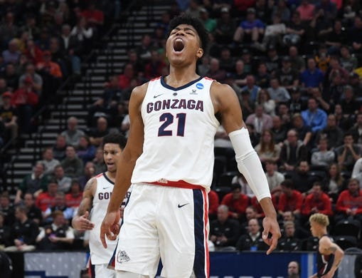 Mar 21, 2019; Salt Lake City, UT, USA; Gonzaga Bulldogs forward Rui Hachimura (21) reacts against the Fairleigh Dickinson Knights in the first half in the first round of the 2019 NCAA Tournament at Vivint Smart Home Arena. Mandatory Credit: Kirby Lee-USA TODAY Sports