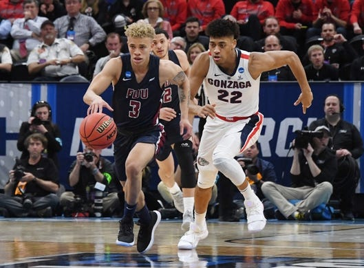Mar 21, 2019; Salt Lake City, UT, USA; Fairleigh Dickinson Knights guard Jahlil Jenkins (3) brings the ball up court against Gonzaga Bulldogs forward Jeremy Jones (22) in the first half in the first round of the 2019 NCAA Tournament at Vivint Smart Home Arena. Mandatory Credit: Kirby Lee-USA TODAY Sports