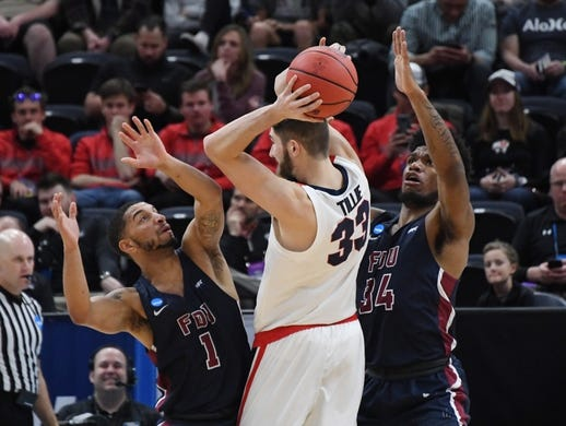 Mar 21, 2019; Salt Lake City, UT, USA; Gonzaga Bulldogs forward Killian Tillie (33) is defended by Fairleigh Dickinson Knights guard Darnell Edge (1) and forward Mike Holloway Jr. (34)  during the first half in the first round of the 2019 NCAA Tournament at Vivint Smart Home Arena. Mandatory Credit: Kirby Lee-USA TODAY Sports