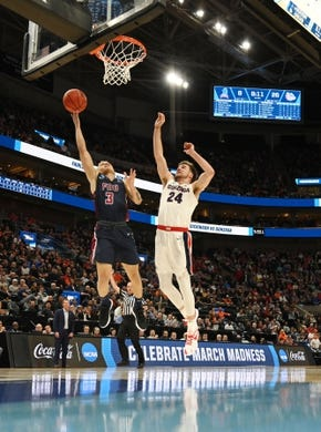 Mar 21, 2019; Salt Lake City, UT, USA; Fairleigh Dickinson Knights guard Jahlil Jenkins (3) shoots against Gonzaga Bulldogs forward Corey Kispert (24) during the first half in the first round of the 2019 NCAA Tournament at Vivint Smart Home Arena. Mandatory Credit: Kirby Lee-USA TODAY Sports