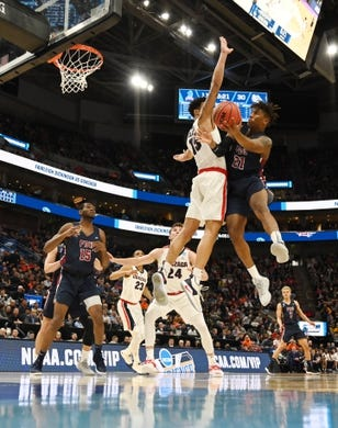 Mar 21, 2019; Salt Lake City, UT, USA; Fairleigh Dickinson Knights forward Elyjah Williams (21) shoots against Gonzaga Bulldogs forward Brandon Clarke (15) during the first half in the first round of the 2019 NCAA Tournament at Vivint Smart Home Arena. Mandatory Credit: Kirby Lee-USA TODAY Sports