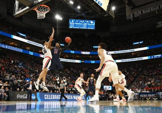 Mar 21, 2019; Salt Lake City, UT, USA; Fairleigh Dickinson Knights forward Kaleb Bishop (12) shoots against Gonzaga Bulldogs forward Brandon Clarke (15) during the first half in the first round of the 2019 NCAA Tournament at Vivint Smart Home Arena. Mandatory Credit: Kirby Lee-USA TODAY Sports