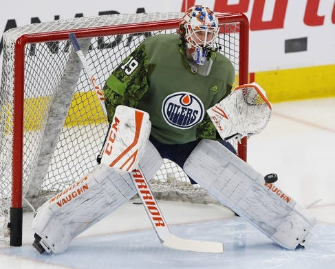 Mar 21, 2019; Edmonton, Alberta, CAN; Edmonton Oilers goaltender Mikko Koskinen (19) makes a save during warmup against the Columbus Blue Jackets at Rogers Place. Mandatory Credit: Perry Nelson-USA TODAY Sports