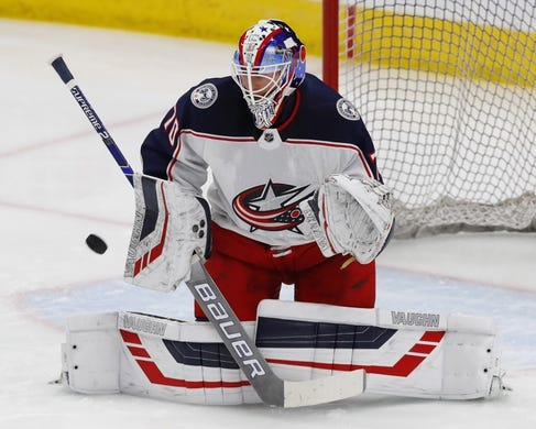 Mar 21, 2019; Edmonton, Alberta, CAN; Columbus Blue Jackets goaltender Joonas Korpisalo (70) makes a save during warmup against the Edmonton Oilers at Rogers Place. Mandatory Credit: Perry Nelson-USA TODAY Sports