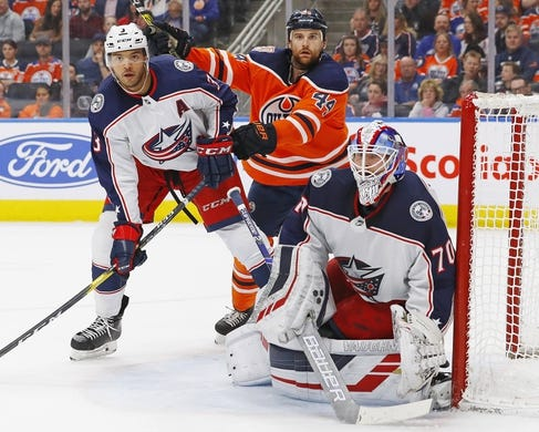 Mar 21, 2019; Edmonton, Alberta, CAN; Edmonton Oilers forward Zack Kassian (44) and Columbus Blue Jackets defensemen Seth Jones (3) battle in front of goaltender Joonas Korpisalo (70) during the first period at Rogers Place. Mandatory Credit: Perry Nelson-USA TODAY Sports