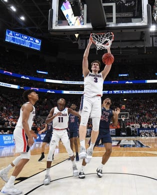 Mar 21, 2019; Salt Lake City, UT, USA; Gonzaga Bulldogs forward Filip Petrusev (3) dunks against the Fairleigh Dickinson Knights during the second half in the first round of the 2019 NCAA Tournament at Vivint Smart Home Arena. Mandatory Credit: Kirby Lee-USA TODAY Sports