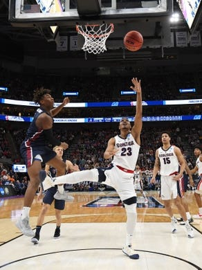 Mar 21, 2019; Salt Lake City, UT, USA; Gonzaga Bulldogs guard Zach Norvell Jr. (23) shoots against the Fairleigh Dickinson Knights during the second half in the first round of the 2019 NCAA Tournament at Vivint Smart Home Arena. Mandatory Credit: Kirby Lee-USA TODAY Sports