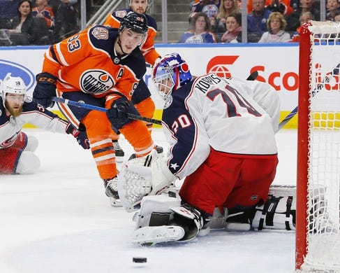Mar 21, 2019; Edmonton, Alberta, CAN; Edmonton Oilers forward Ryan Nugent-Hopkins (93) puts a shot just wide of Columbus Blue Jackets goaltender Joonas Korpisalo (70) during the first period at Rogers Place. Mandatory Credit: Perry Nelson-USA TODAY Sports