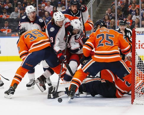 Mar 21, 2019; Edmonton, Alberta, CAN;  Both the Edmonton Oilers and the Columbus Blue Jackets look for a loose puck beside the Edmonton Oilers net during the second period at Rogers Place. Mandatory Credit: Perry Nelson-USA TODAY Sports