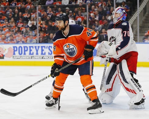 Mar 21, 2019; Edmonton, Alberta, CAN; Edmonton Oilers forward Zack Kassian (44) tries to screen Columbus Blue Jackets goaltender Joonas Korpisalo (70) during the third period at Rogers Place. Mandatory Credit: Perry Nelson-USA TODAY Sports
