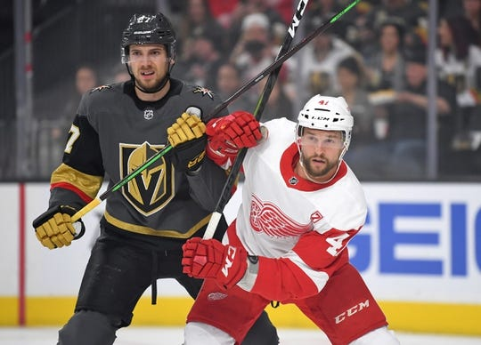 Mar 23, 2019; Las Vegas, NV, USA; Vegas Golden Knights defenseman Shea Theodore (27) lifts the stick of Detroit Red Wings center Luke Glendening (41) during the first period at T-Mobile Arena. Mandatory Credit: Stephen R. Sylvanie-USA TODAY Sports