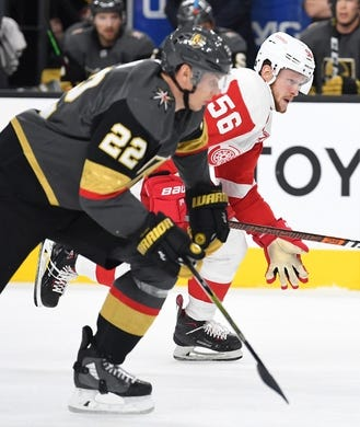 Mar 23, 2019; Las Vegas, NV, USA; Detroit Red Wings left wing Ryan Kuffner (56) skates ahead of Vegas Golden Knights defenseman Nick Holden (22) during the first period at T-Mobile Arena. Mandatory Credit: Stephen R. Sylvanie-USA TODAY Sports