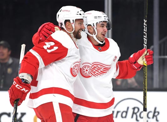 Mar 23, 2019; Las Vegas, NV, USA; Detroit Red Wings center Luke Glendening (41) celebrates with Detroit Red Wings left wing Taro Hirose (53) after scoring a first period goal against the Vegas Golden Knights at T-Mobile Arena. Mandatory Credit: Stephen R. Sylvanie-USA TODAY Sports