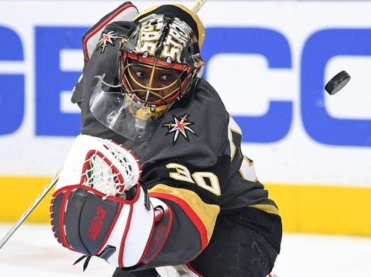 Mar 23, 2019; Las Vegas, NV, USA; Vegas Golden Knights goaltender Malcolm Subban (30) deflects a shot during the first period against the Detroit Red Wings at T-Mobile Arena. Mandatory Credit: Stephen R. Sylvanie-USA TODAY Sports