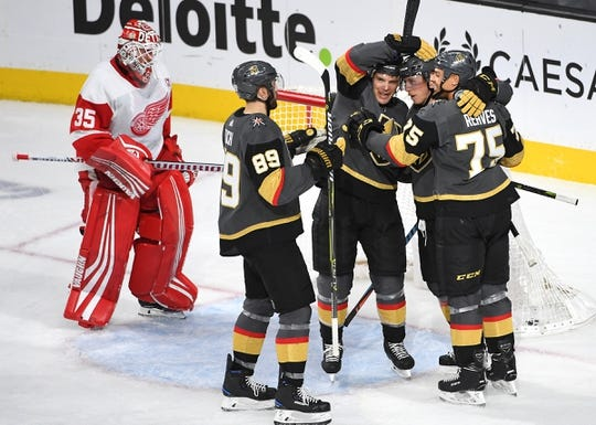 Mar 23, 2019; Las Vegas, NV, USA; Vegas Golden Knights players celebrate a power play goal scored by Vegas Golden Knights center Cody Eakin (21) during the second period against the Detroit Red Wings at T-Mobile Arena. Mandatory Credit: Stephen R. Sylvanie-USA TODAY Sports