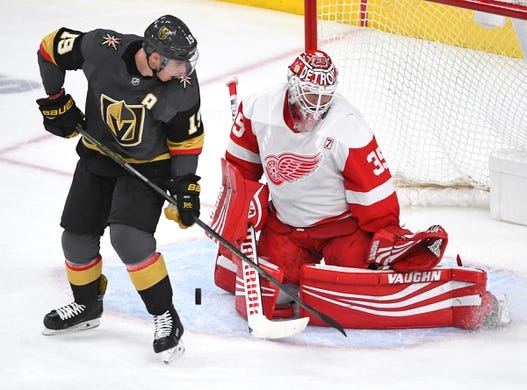 Mar 23, 2019; Las Vegas, NV, USA; Detroit Red Wings goaltender Jimmy Howard (35) makes the save as Vegas Golden Knights right wing Reilly Smith (19) looks for a deflection during the second period at T-Mobile Arena. Mandatory Credit: Stephen R. Sylvanie-USA TODAY Sports