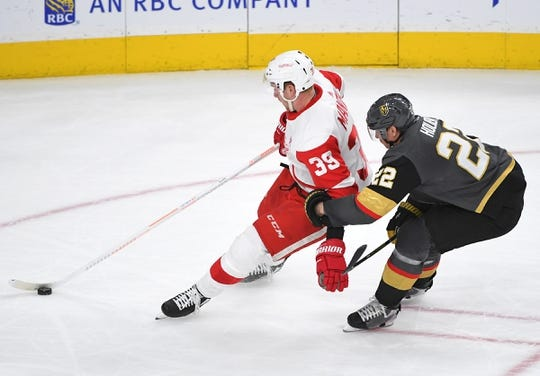 Mar 23, 2019; Las Vegas, NV, USA; Vegas Golden Knights defenseman Nick Holden (22) grabs the arm of Detroit Red Wings right wing Anthony Mantha (39) drawing a penalty during the second period at T-Mobile Arena. Mandatory Credit: Stephen R. Sylvanie-USA TODAY Sports