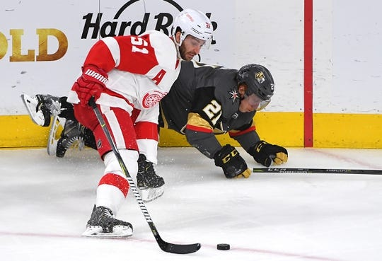 Mar 23, 2019; Las Vegas, NV, USA; Detroit Red Wings center Frans Nielsen (51) takes the puck after checking Vegas Golden Knights center Cody Eakin (21) during the second period at T-Mobile Arena. Mandatory Credit: Stephen R. Sylvanie-USA TODAY Sports