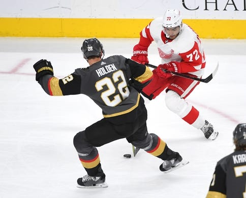 Mar 23, 2019; Las Vegas, NV, USA; Vegas Golden Knights defenseman Nick Holden (22) steals the puck from Detroit Red Wings center Andreas Athanasiou (72) during the second period at T-Mobile Arena. Mandatory Credit: Stephen R. Sylvanie-USA TODAY Sports
