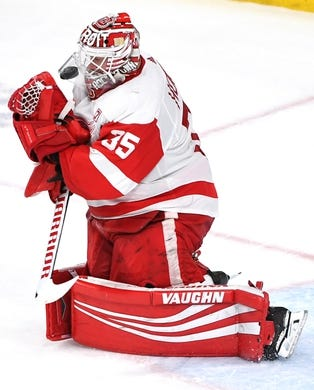 Mar 23, 2019; Las Vegas, NV, USA; Detroit Red Wings goaltender Jimmy Howard (35) makes the save as the puck deflects under his chin protector during the second period against the Vegas Golden Knights at T-Mobile Arena. Mandatory Credit: Stephen R. Sylvanie-USA TODAY Sports