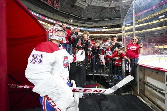 Mar 24, 2019; Raleigh, NC, USA;  Montreal Canadiens goaltender Carey Price (31) goes past the fans before the game against the Carolina Hurricanes at PNC Arena. The Carolina Hurricanes defeated the Montreal Canadiens 2-1. Mandatory Credit: James Guillory-USA TODAY Sports