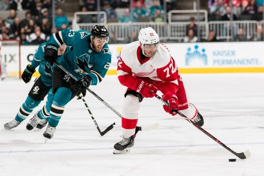 Mar 25, 2019; San Jose, CA, USA; Detroit Red Wings center Andreas Athanasiou (72) looks to pass against the San Jose Sharks in the first period at SAP Center at San Jose. Mandatory Credit: John Hefti-USA TODAY Sports