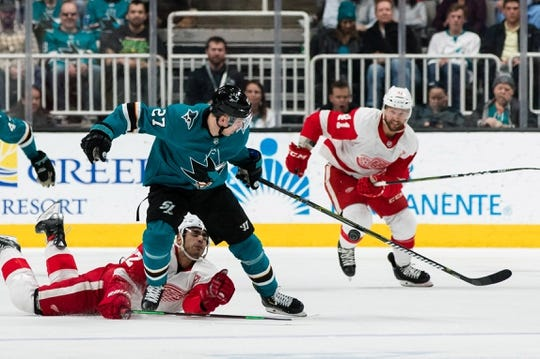 Mar 25, 2019; San Jose, CA, USA; Detroit Red Wings center Andreas Athanasiou (72) collides with San Jose Sharks right wing Joonas Donskoi (27) in the second period at SAP Center at San Jose. Mandatory Credit: John Hefti-USA TODAY Sports