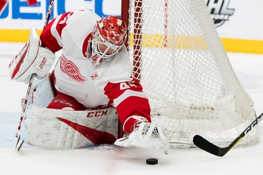 Mar 25, 2019; San Jose, CA, USA; Detroit Red Wings goaltender Jonathan Bernier (45) reaches for the puck against the San Jose Sharks in the second period at SAP Center at San Jose. Mandatory Credit: John Hefti-USA TODAY Sports