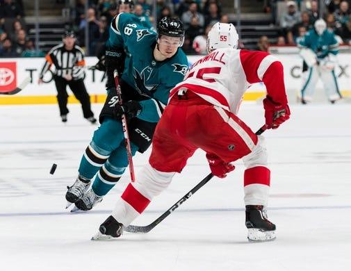 Mar 25, 2019; San Jose, CA, USA; San Jose Sharks center Tomas Hertl (48) dribbles past Detroit Red Wings defenseman Niklas Kronwall (55) in the second period at SAP Center at San Jose. Mandatory Credit: John Hefti-USA TODAY Sports