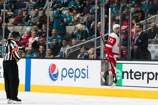 Mar 25, 2019; San Jose, CA, USA; Detroit Red Wings center Michael Rasmussen (27) gets a two-minute penalty after fouling San Jose Sharks right wing Joonas Donskoi (not shown) in the second period at SAP Center at San Jose. Mandatory Credit: John Hefti-USA TODAY Sports