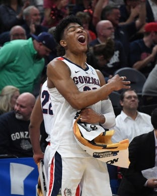 Mar 21, 2019; Salt Lake City, UT, USA; Gonzaga Bulldogs forward Rui Hachimura (21) celebrates against the Fairleigh Dickinson Knights  in the first round of the 2019 NCAA Tournament at Vivint Smart Home Arena. Gonzaga defeated Farleigh Dickinson 87-49. Mandatory Credit: Kirby Lee-USA TODAY Sports